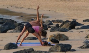 man-and-woman-yoga-on-the-beach